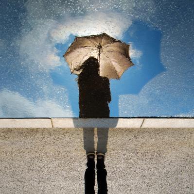 person in the rainholding umbrella - back view