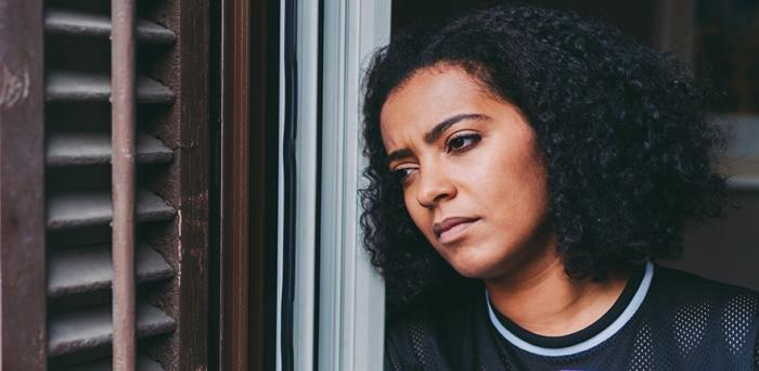 Young woman looking pensive and sad