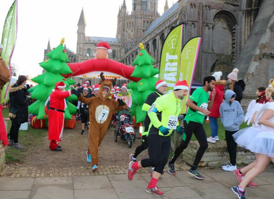The grounds of Ely Cathedral once again provide a stunning backdrop for the start and finish line of Ely Festive 5K, which takes place this year on Sunday 24 November 2019.