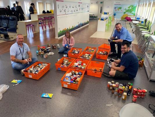 More than 50 trays of food and toiletries surrendered at airport security have been delivered by volunteers since March. Stansted Airport Security Officers are pictured sifting through the items and preparing trays for delivery.
