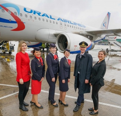Crew of Ural Airlines on the tarmac outside one of its planes