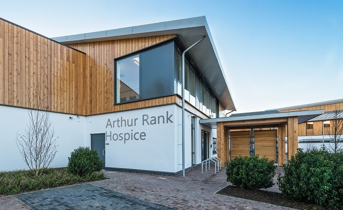 The front of Arthur Rank Hospice Charity's home at Shelford Bottom: the Education and Conference Centre is based in the rooms with large windows above the entrance.