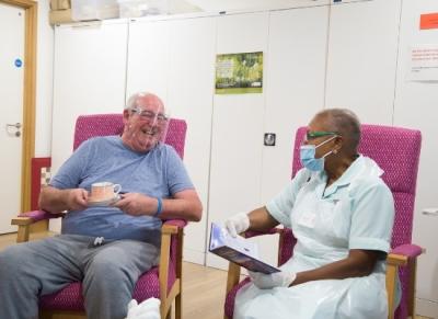 Patient at nurse at ARHC enjoying a cup of tea
