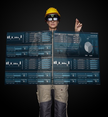 Female worker in hard hat with data screens superimposed over the top