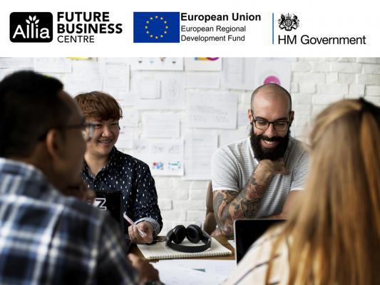 People sitting together at a table_Allia ERDF funding image