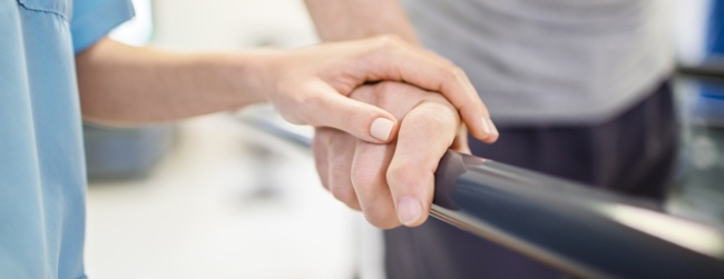two hands on a handrail