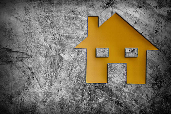 stylised graphic of a yellow house on a grey background