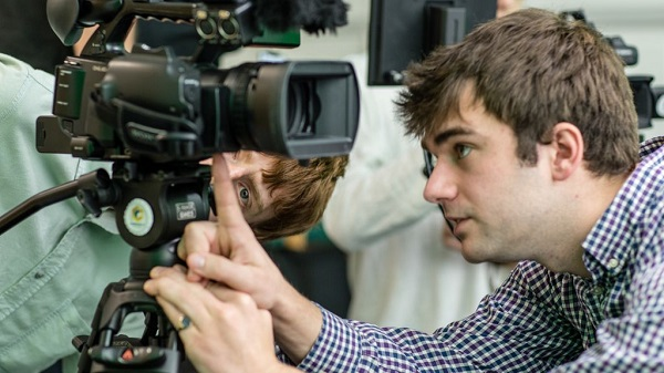 A student being taught camera skills by a tutor at Cambridge TV Training