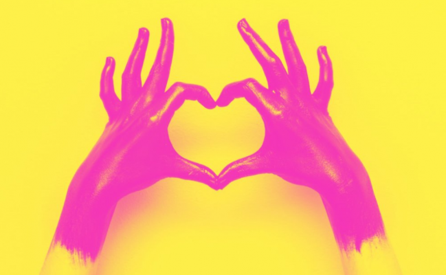 hands with fingers in the shape of a heart