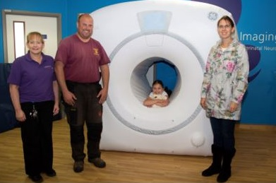 Chloe with inflatable MRI and mum Rachel, dad Rhys and Rosemary