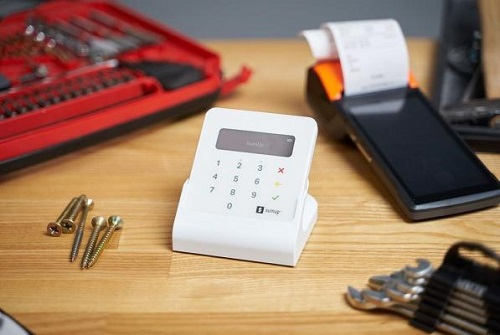 calculator and building materials on a desk