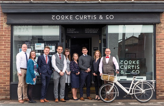 The team at Cooke Curtis & Co - pictured before the pandemic
