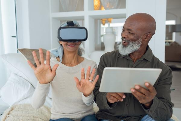 Couple with laptop and virtual reality headset