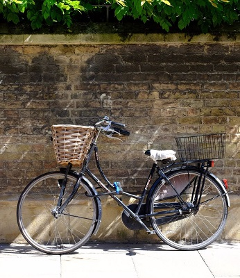 Bicycle leaning against a wall in Cambridge