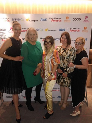 Award joy - Sarah Throssell (second from the left), EACH Head of Central Operations, with representatives from the retail team, Naomi Munro, Chloe Williams, Katie Farrow and Brigitte Youngs.