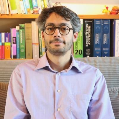 Headshot of  Dr Emanuele Osimo wearing a light blue shirt