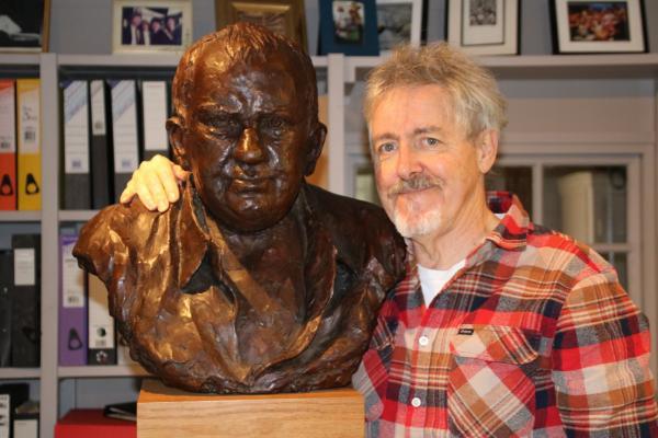 Griff Rhys Jones with Mel Smith bust