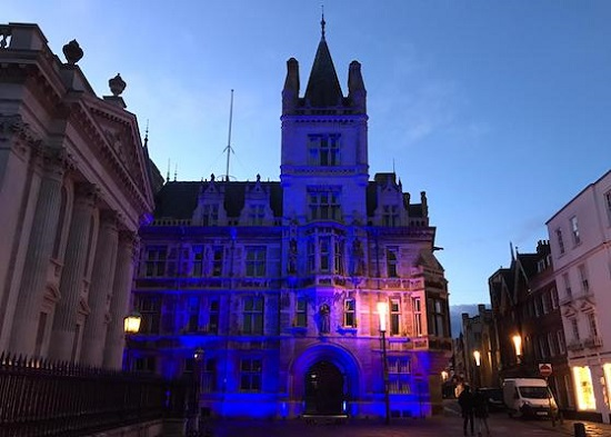 Gonville and Caius lit up in blue