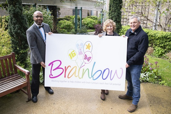 Clinical lead and paediatric oncologist, Dr Amos Burke, with Denise and Sean Tarrant, showing the new Brainbow logo.