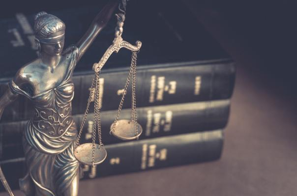Lady Justice with law books