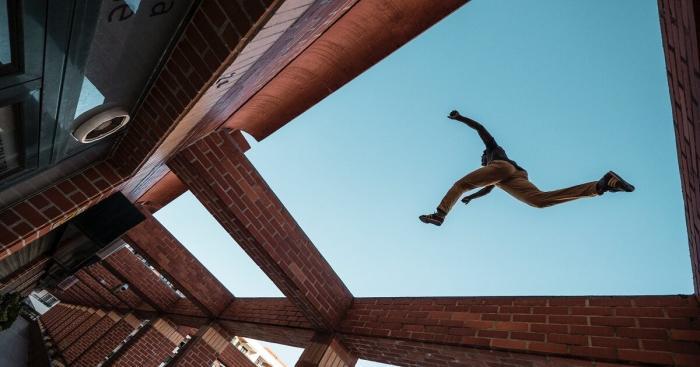 leap of faith_jumping across buildings as seen through a skylight