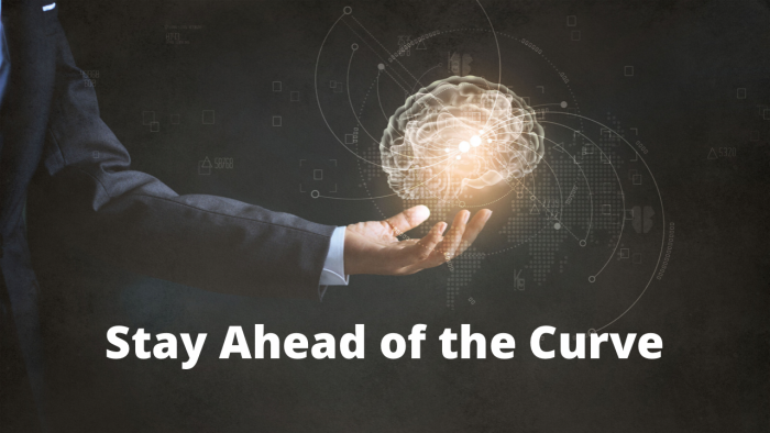 man's hand holding a brain shaped light, with the words:  'stay ahead of the curve'