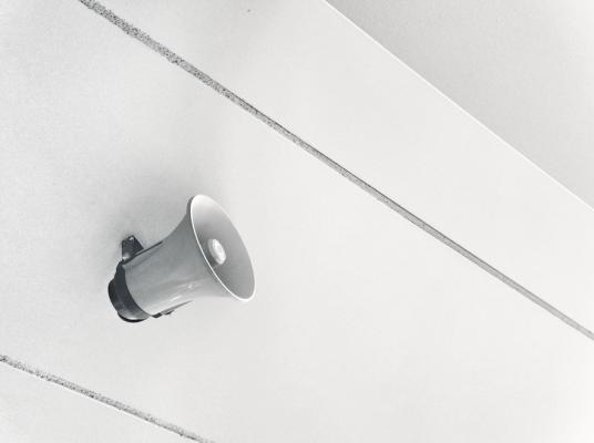 loudspeaker on a blank wall