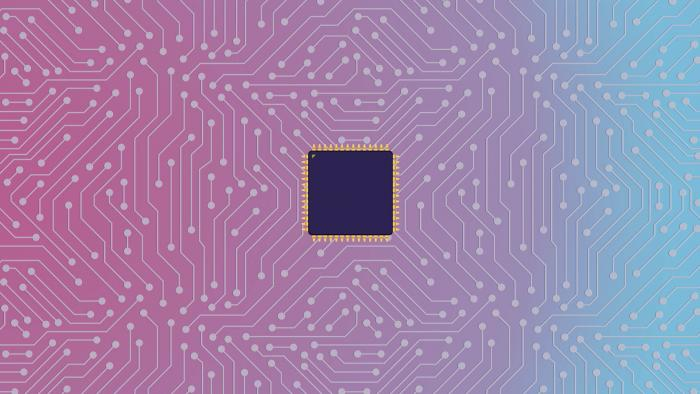 PCB showing pink and blue square with black square inthe middle