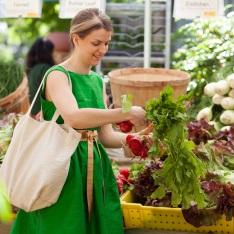 woman examining market produce