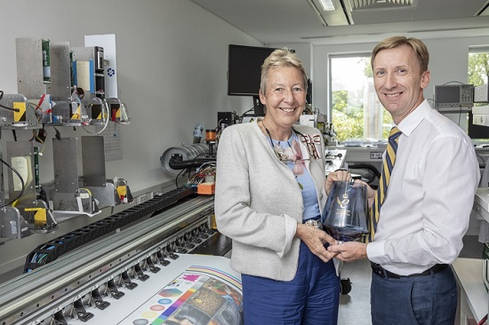 Her Majesty's Lord-Lieutenant of Cambridgeshire, Mrs Julie Spence OBE, presents the glass bowl to  Clive Ayling, Meteor's managing director.