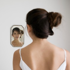 reflection of a woman in a mirror