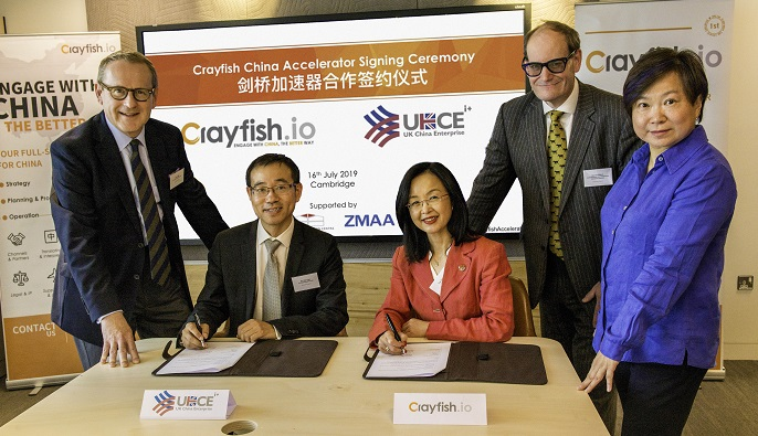 (seated) Dr Jian Cao, partner, UKCE, and Ting Zhang,  Founder and CEO of Crayfish.io, launch the Crayfish China Accelerator Programme