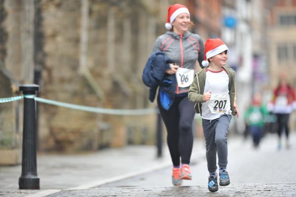 Women and boy running at the Arthur Rank Hospice Charity Festive 5K