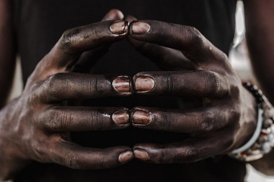Hands clasped together_Photograph by Edith Chiliboy