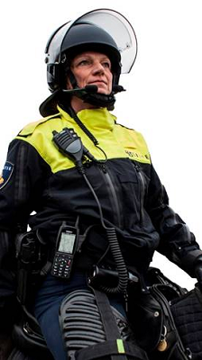 Policewoman wearing safety gear and hand-held mobile devices from Sepura