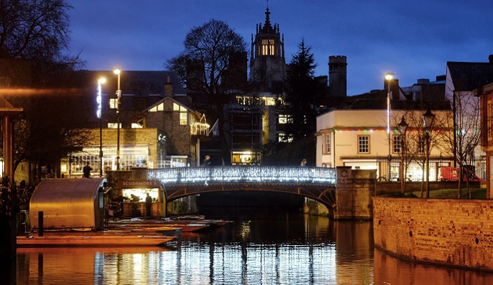 Cambridge at night with Xmas lights on bridge