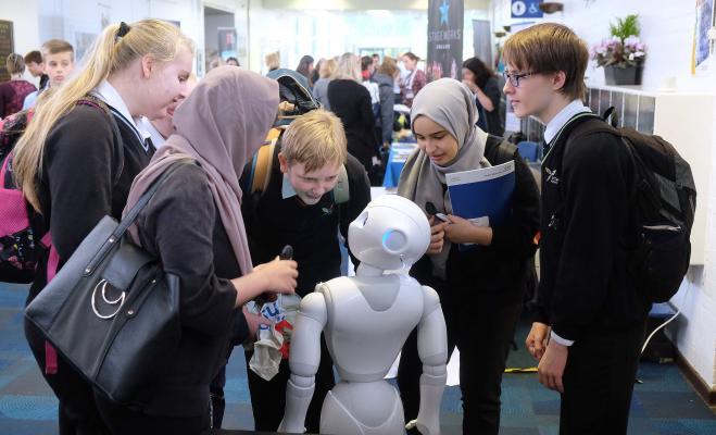 students meet a robot at careers fair