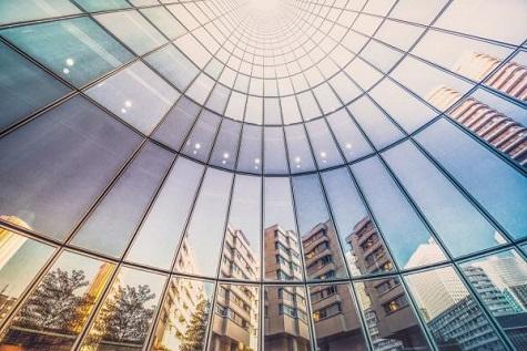 atrium windows reflect city skyline