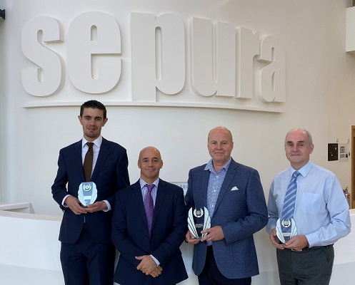 Sepura representatives receive the Shea Global Business Better Award. Left to right; James Phillips, Customer Support Engineer, Sepura; Jonathan Smyth, Commercial Director EMEA, SHEA Global; Duncan Crouch, Operations Director, Sepura; Michael Hughes, AX Project Manager & System Architect, Sepura.