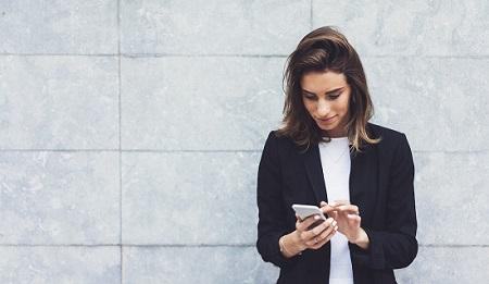 Woman using mobile phone app