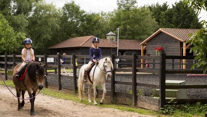 children on horseback_South Cambridgeshire Equestrian Centre