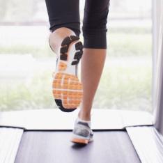 legs running on a treadmill