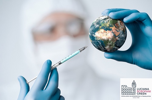 masked person injecting a mini 'globe'