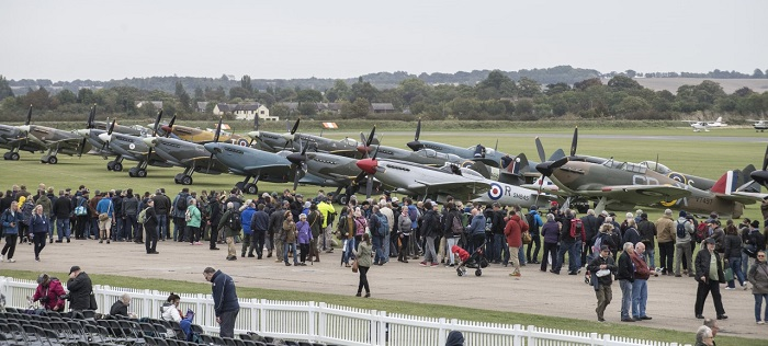 © IWM  Visitors to the 2018 Battle of Britain Air Show enjoying  the historic aircraft on the flightline walk
