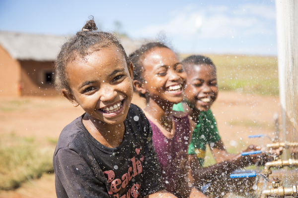 Girls happy to be washing their hands at their school's facilities provided by WaterAid, Madagascar. Credit: WaterAid/ Ernest Randriarimalala