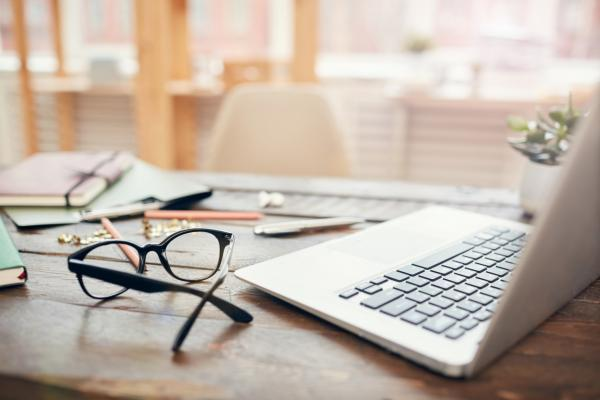 laptop, spectacles and notebook - working fvrom home image