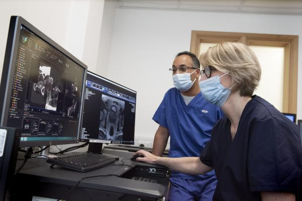 Dr Raj Jena, an Oncologist at Addenbrooke's and Co-Lead of InnerEye, looks at scans with with Consultant Clinical Oncologist Yvonne Rimmer