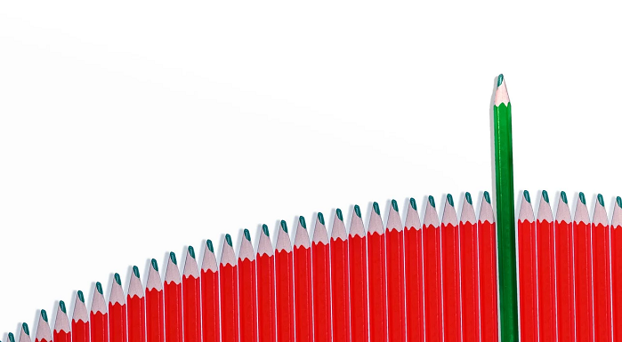Green pencil stands out in a line of red pencils
