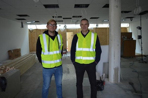 Crispin and Rob standing in the soon-to-be new office space