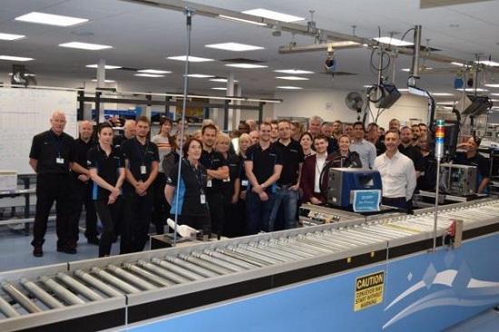 The team at Domino Printing celebrates major production milestone